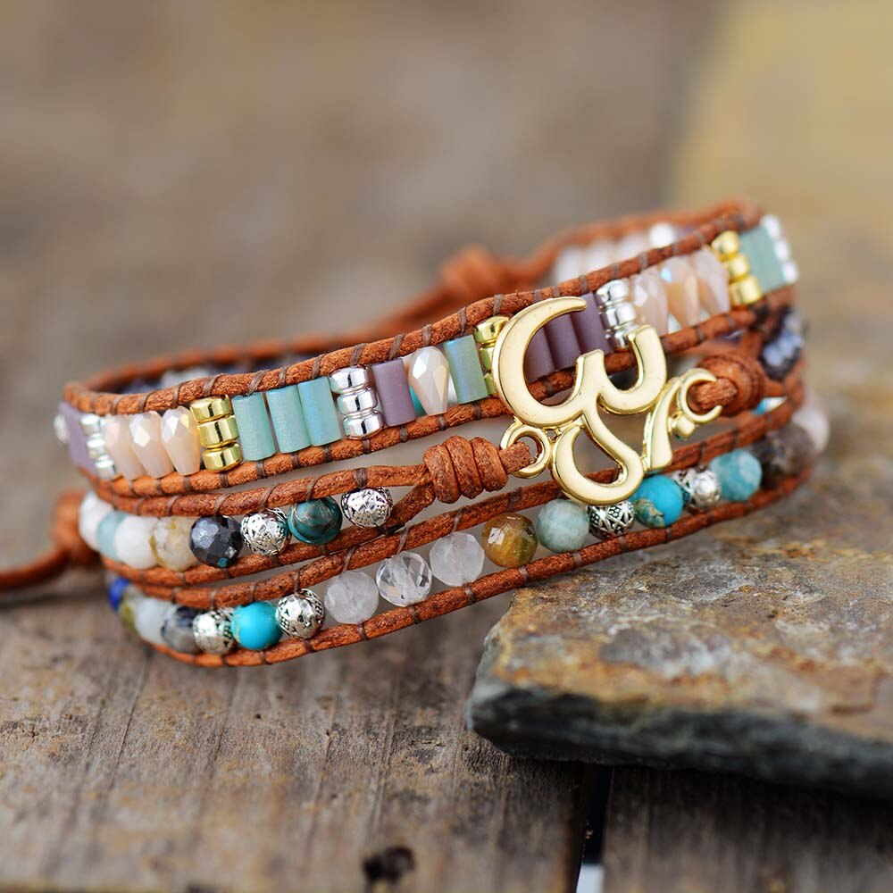LEATHER WRAP BRACELET WITH STONES AND OM CHARM