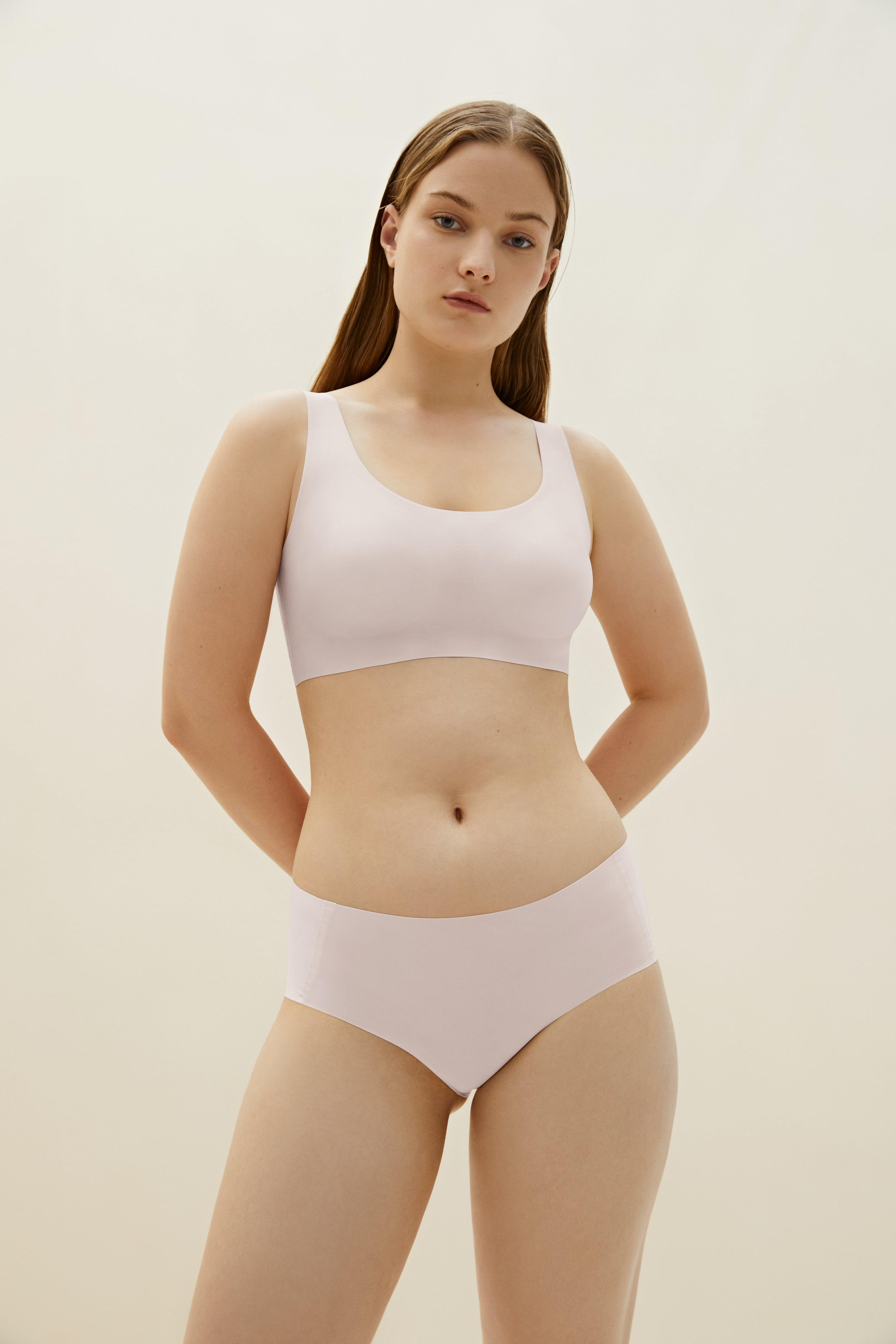 Model wearing NEIWAI's Barely Zero bra and brief set in soft pink.