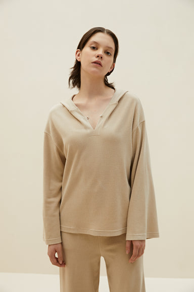 Model wearing NEIWAI's Boundless Modal V-Neck Hoodie in Biscotti.
