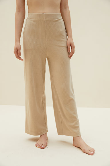 Model wearing NEIWAI's Boundless Modal Straight Leg Pants in Biscotti.
