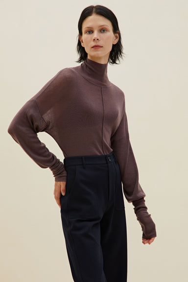 Model wearing NEIWAI's Classic Merino Wool Turtleneck Sweater in Purple Dove.