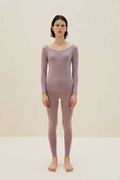 Model wearing NEIWAI's Classic Form-fitting Thermal Underwear Set in Purple Dove.