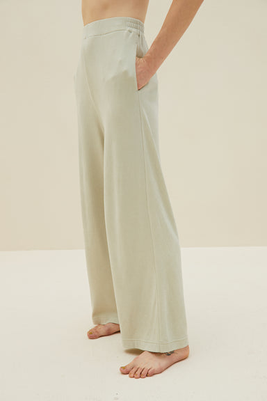 Model wearing NEIWAI's Boundless Modal Straight Leg Pants in Asparagus Green.