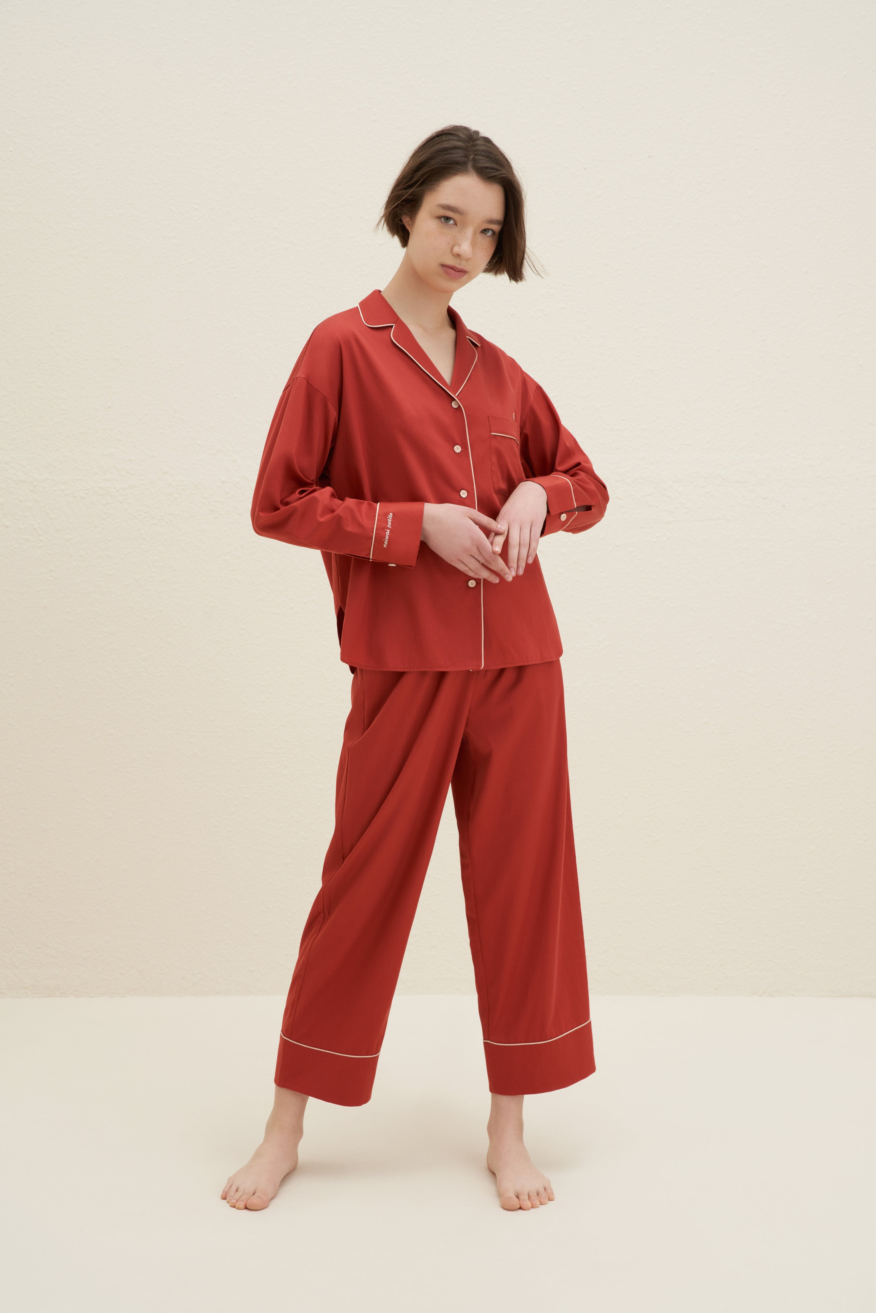 Model wearing NEIWAI's Classic Embroidered Pajama Shirt in Baked Clay.