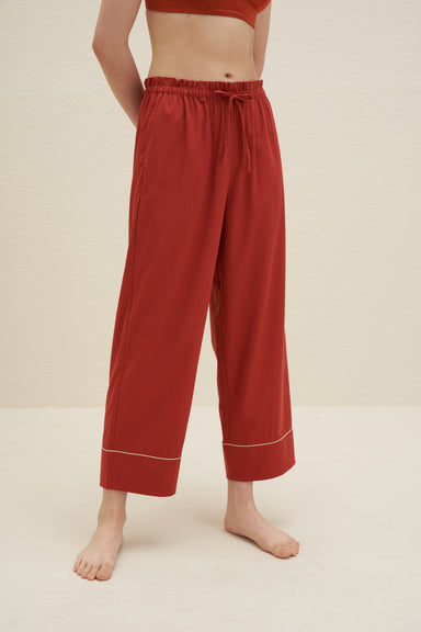Model wearing NEIWAI's Classic Embroidered Straight Leg Pajama Pants in Baked Clay.