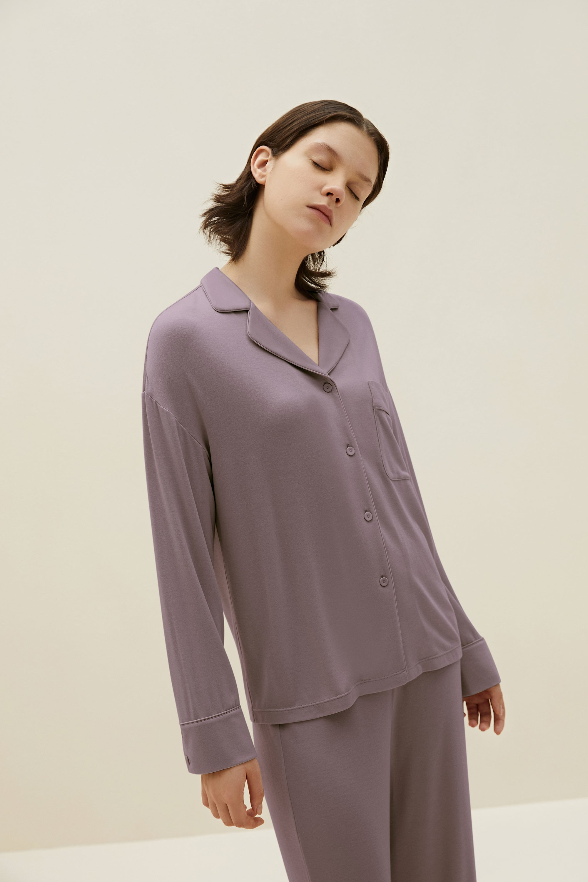 Model wearing NEIWAI's Classic Cozy Button-Up Pajama Top in Purple Dove.