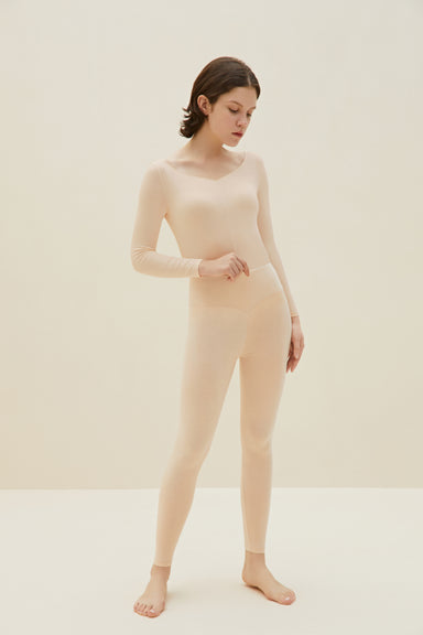 Model wearing NEIWAI's Classic Form-fitting Thermal Underwear Set in Petal Pink.