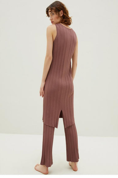 Model wearing NEIWAI's Knitted Split Hem Dress in Plum.