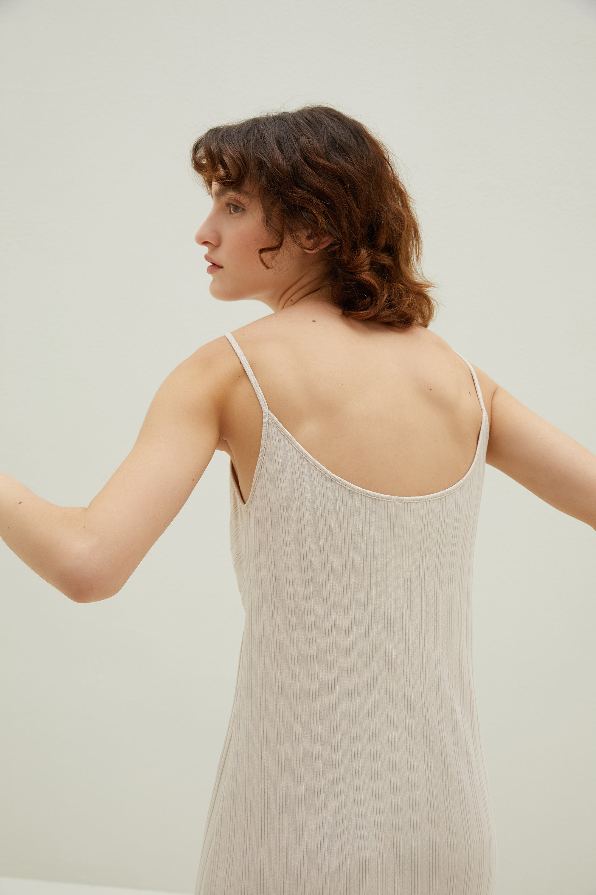 Model wearing NEIWAI's Laid Back Ribbed V-tie Padded Slip Dress in Soft Pink.
