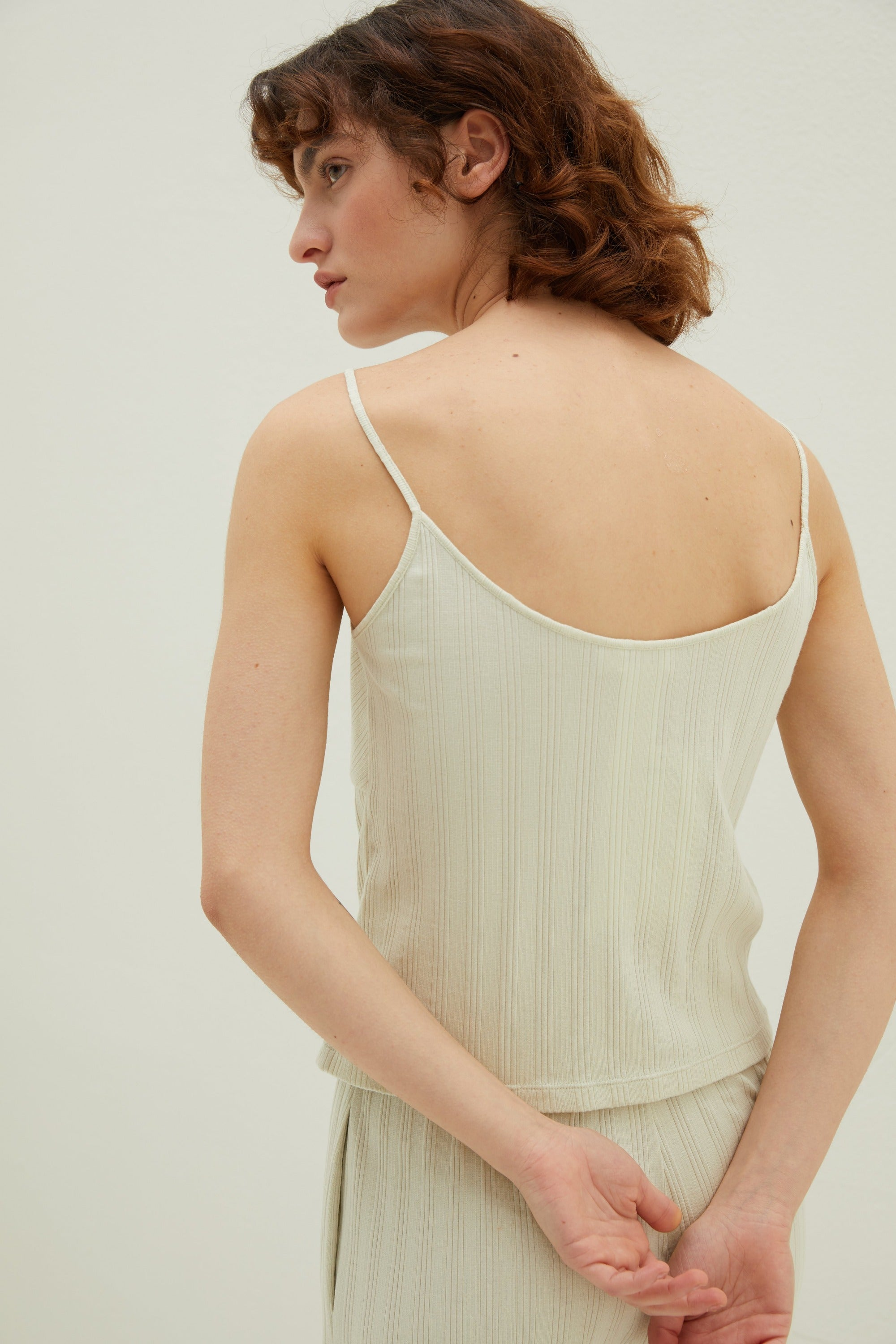 Model wearing NEIWAI's Laid Back Ribbed V-Neck Cami in Mojito.