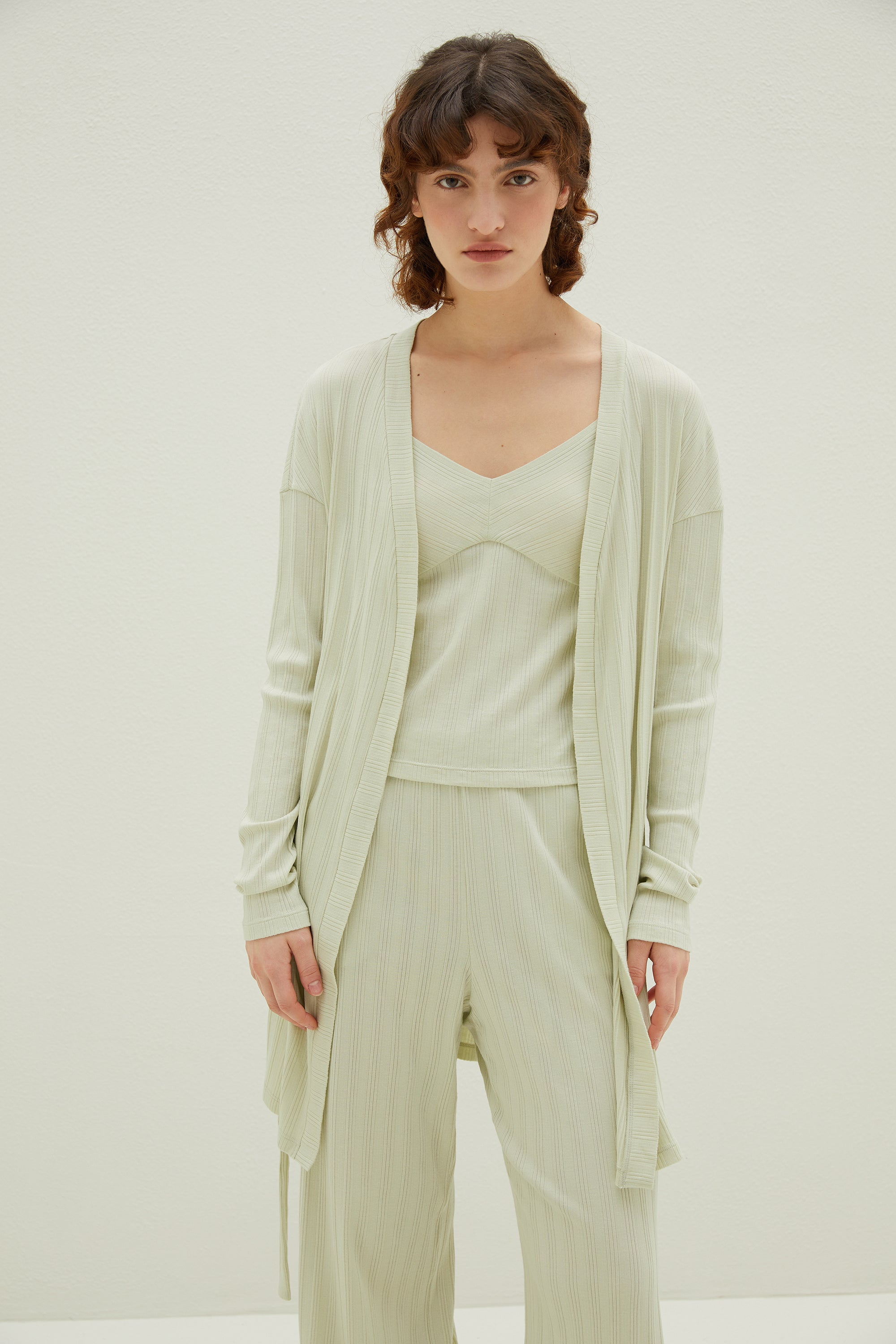 Model wearing NEIWAI's Laid Back Ribbed Lounge Pants in Mojito.