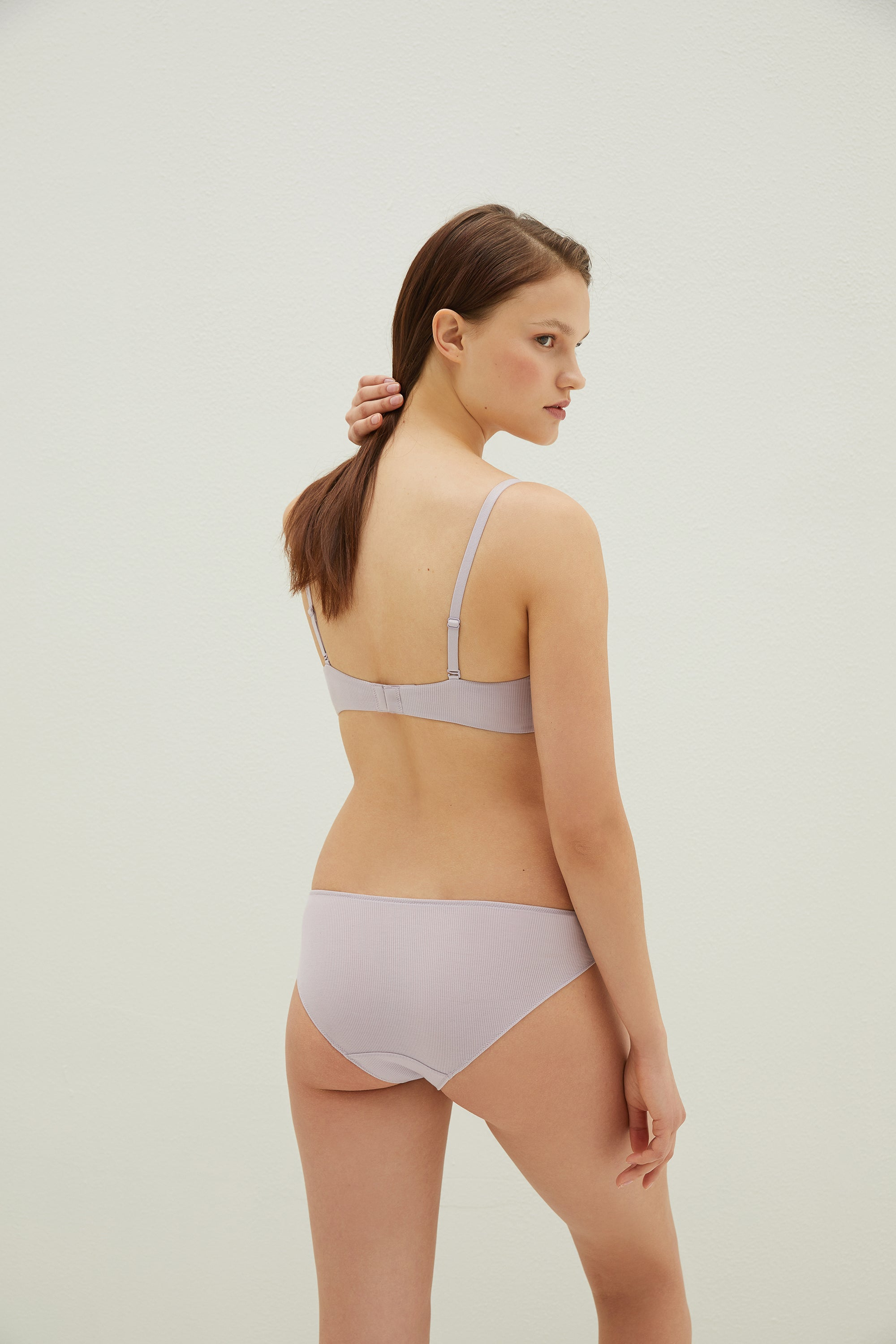Model wearing NEIWAI's Pure Beauty V-shape TENCEL™ Low Waist Brief in Lavender.