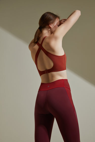 NEIWAI ACTIVE Cross Back Sports Bra in Orange Rust. Cross Straps