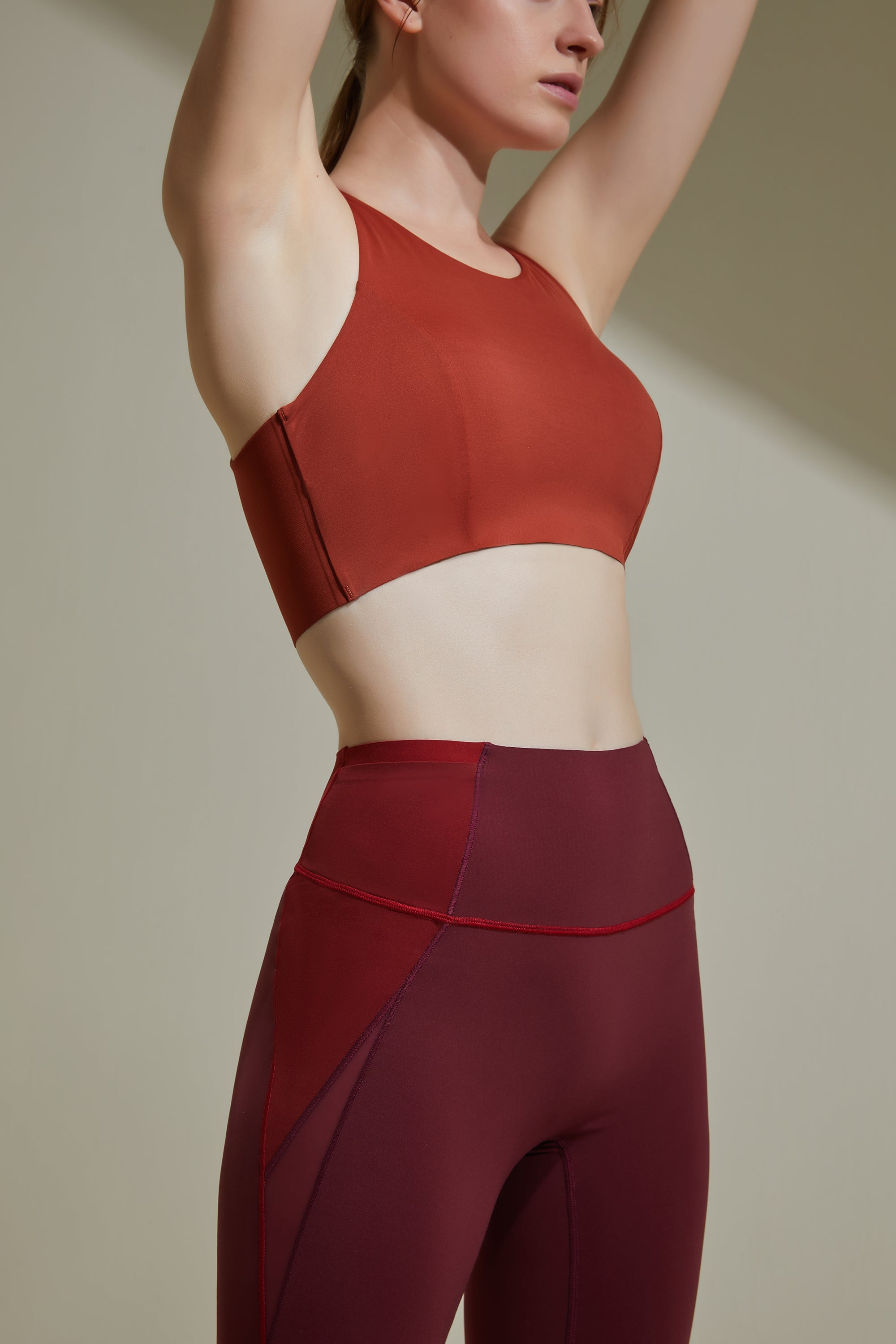 NEIWAI ACTIVE Cross Back Sports Bra in Orange Rust.