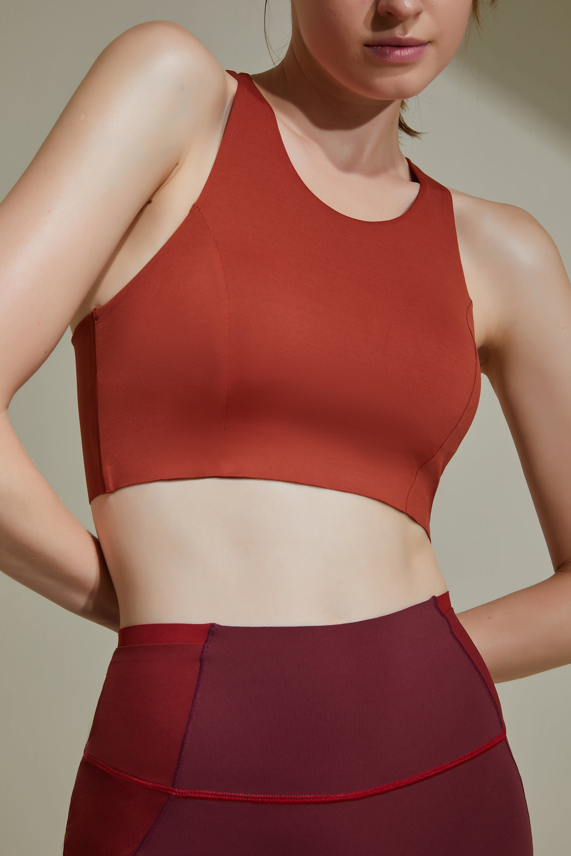 NEIWAI ACTIVE Cross Back Sports Bra in Orange Rust. Moderate Coverage