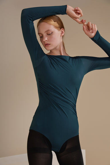 Model wearing the NEIWAI ACTIVE x Yuan Yuan Tan Long-Sleeve V-back Ballet Bodysuit in Bluesteel.
