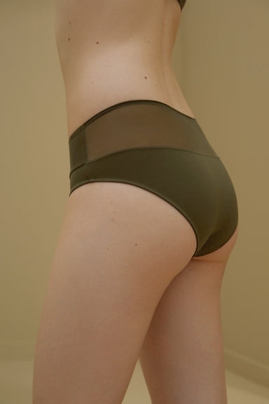 Model wearing NEIWAI's Pure Beauty Matte Mesh Mid Waist Brief in Olive.