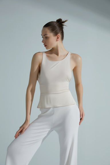 Model wearing the NEIWAI ACTIVE x Yuan Yuan Tan Low Back Ballet Top in Light Pink.