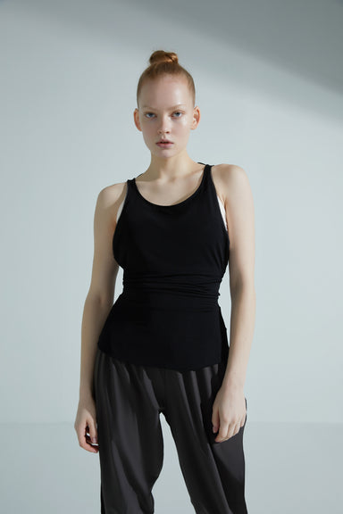 Model wearing the NEIWAI ACTIVE x Yuan Yuan Tan Low Back Ballet Top in Black.