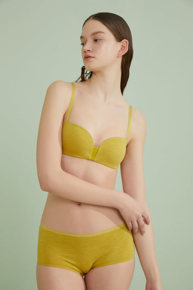 Model wearing NEIWAI's Pure Comfort Turkish Cotton 5/8 Cup Plunge Bra in Warm Olive.