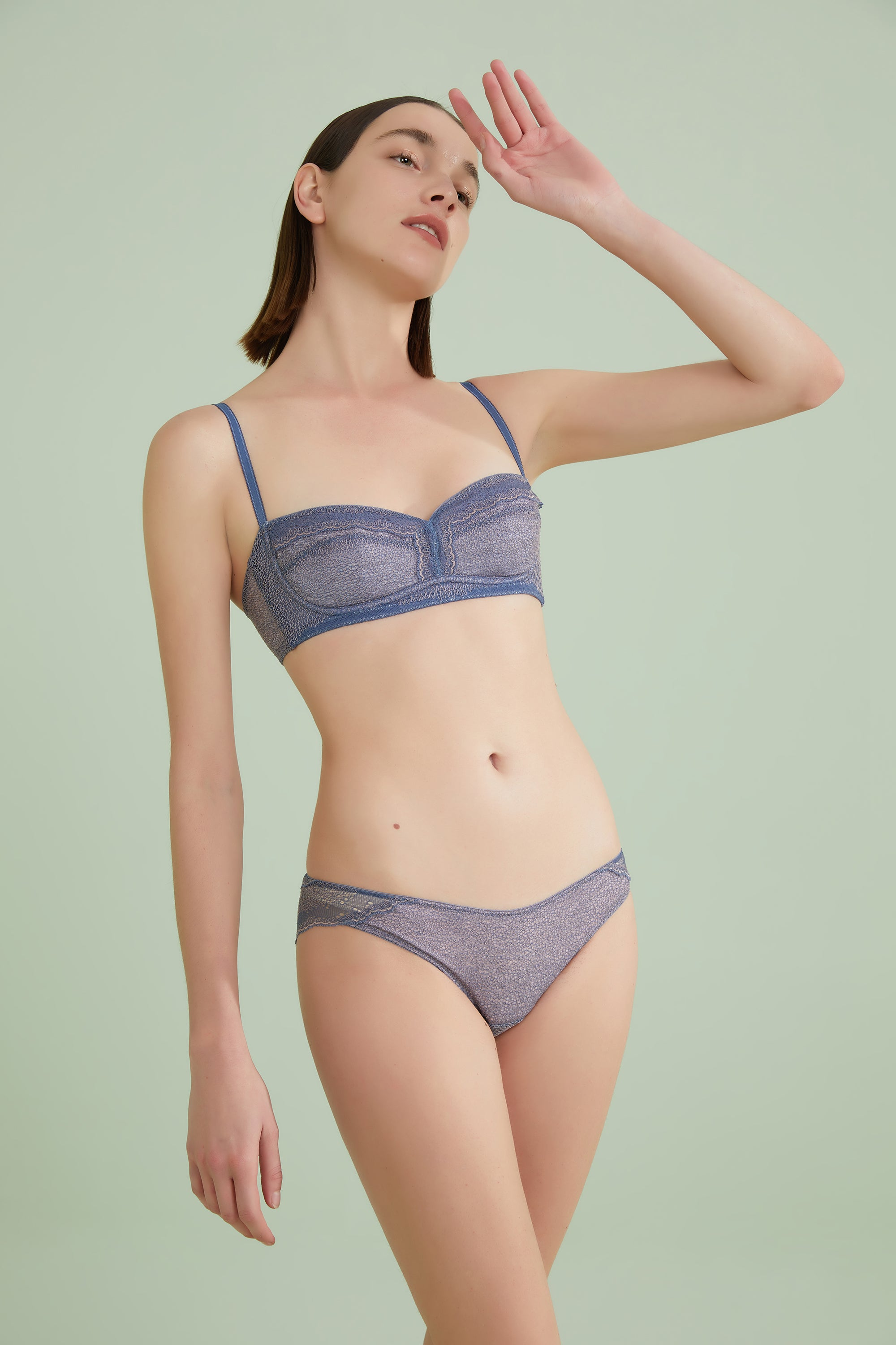 Model wearing NEIWAI's Belle Lace bra and brief set in Twilight Purple.