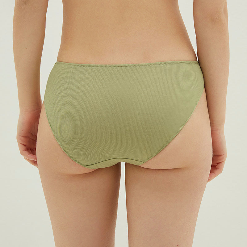 Model wearing NEIWAI's Pure Comfort Ribbed Low Waist Cotton Brief in Avocado.
