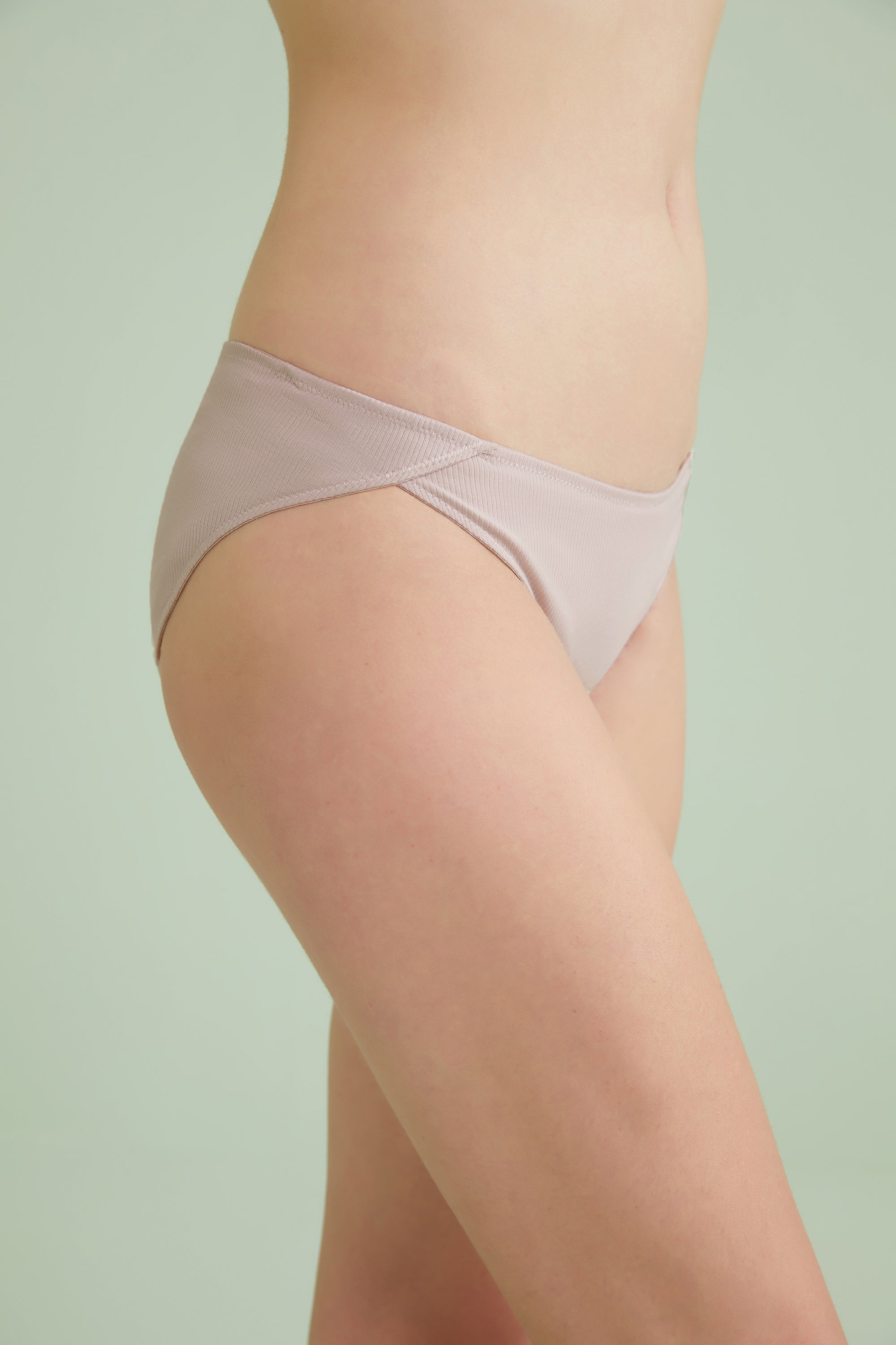 Model wearing NEIWAI's Pure Comfort Ribbed Low Waist Cotton Brief in Pink Nectar.
