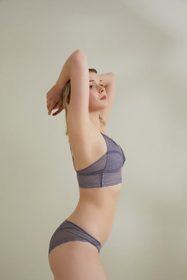 Model wearing NEIWAI's Belle Lace Triangle Bralette and brief set in Twilight Purple.