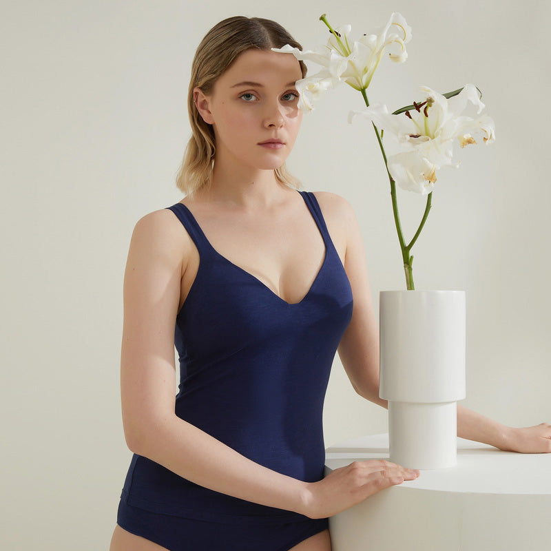 Model wearing NEIWAI's Pure Comfort Supima® Cotton Deep Plunge Cami in Navy.
