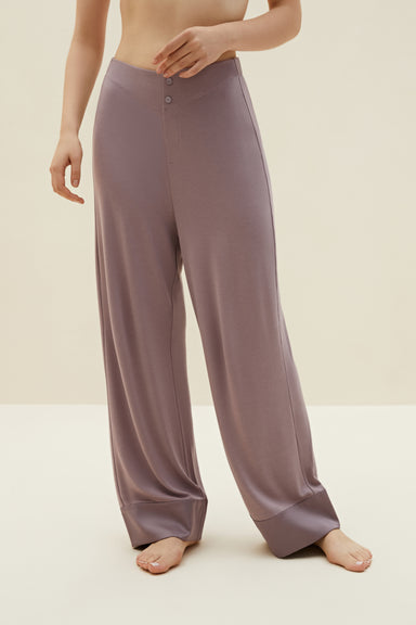 Model wearing NEIWAI's Classic Cozy Pajama Pants in Purple Dove.