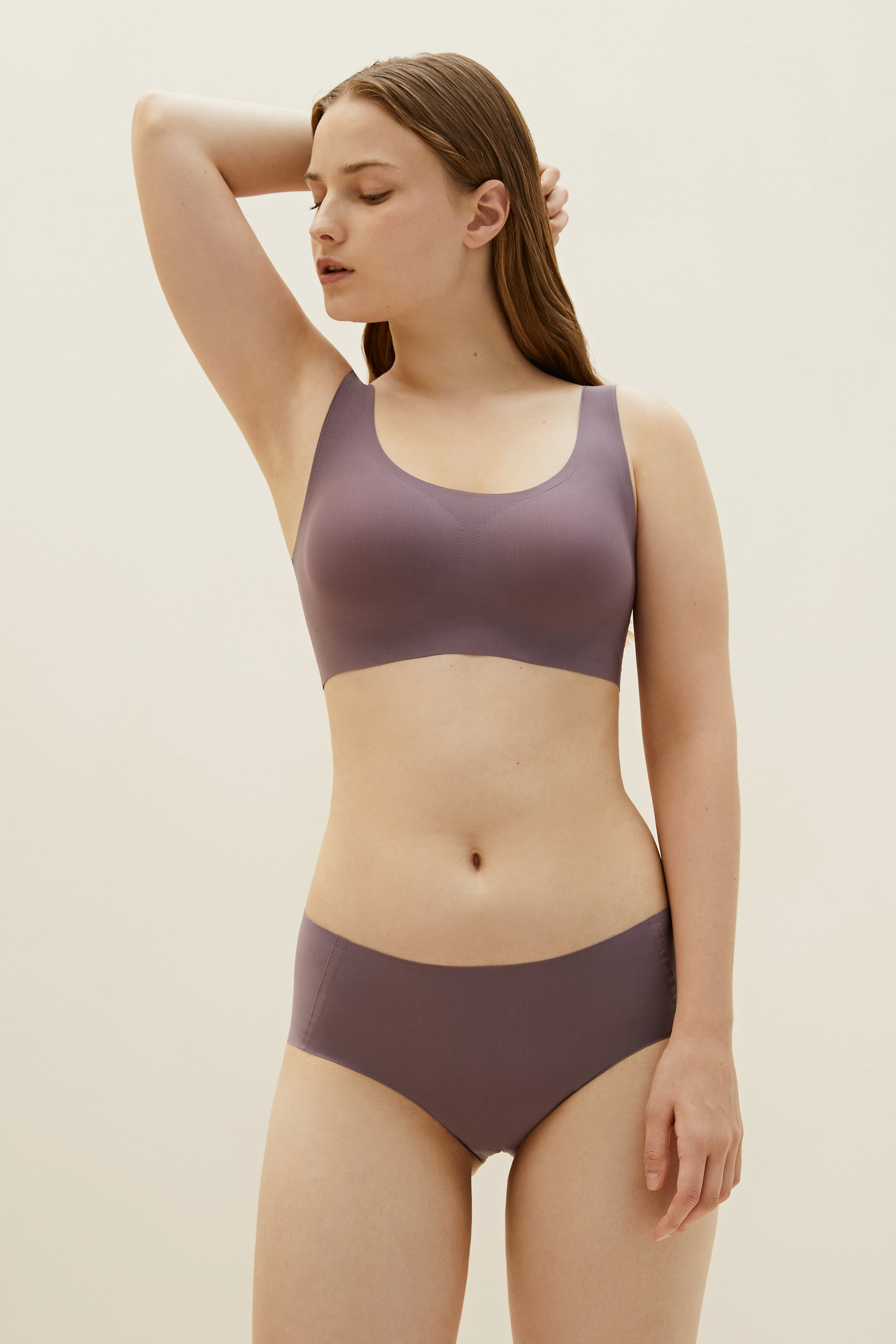 Model wearing NEIWAI's Barely Zero bra and brief set in purple dove.