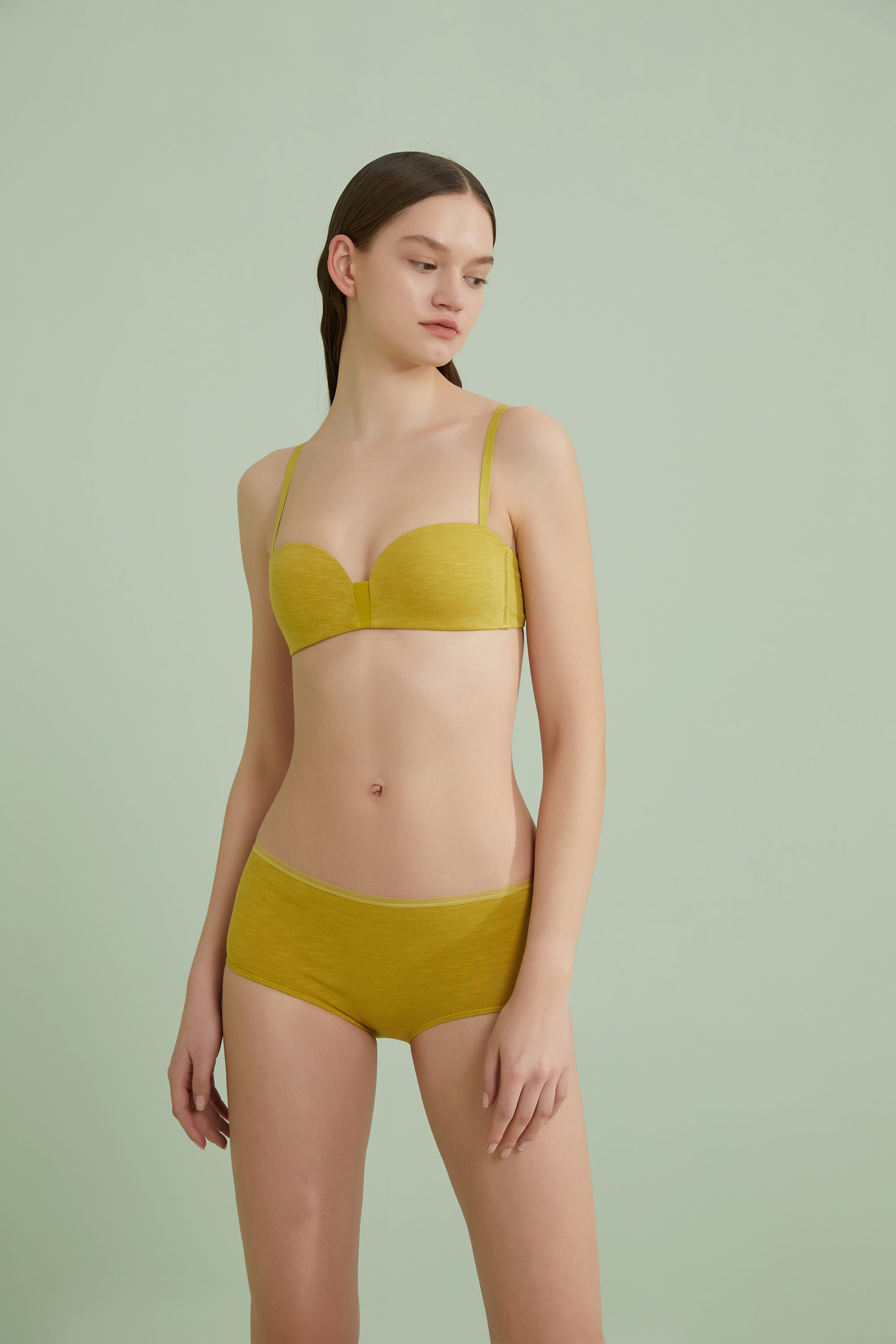 Model wearing NEIWAI's Pure Comfort Turkish Cotton High Waist Brief in Warm Olive.