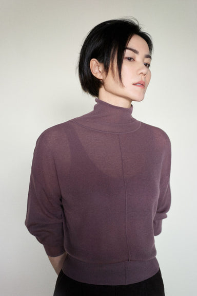Faye Wong modeling NEIWAI's Classic Merino Wool Turtleneck Sweater in Purple Dove.