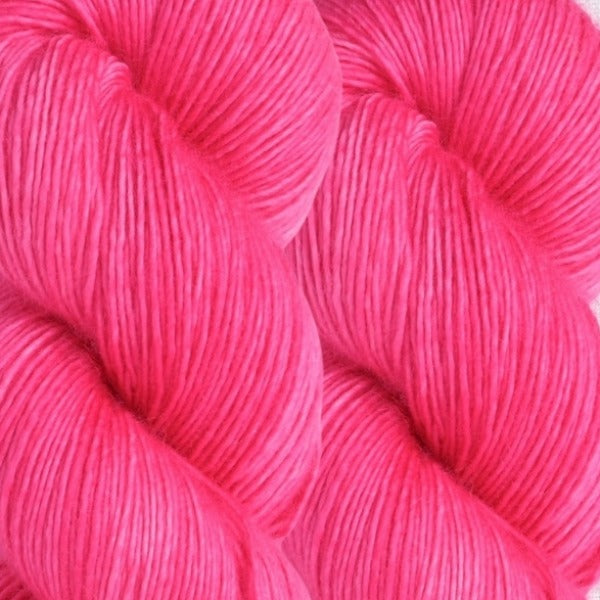 Skein of Madelinetosh A.S.A.P. Super Bulky weight yarn in the color Pop Rocks (Pink) for knitting and crocheting.