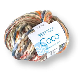 Skein of Berroco Coco Super Bulky weight yarn in the color Prairie (Purple) for knitting and crocheting.