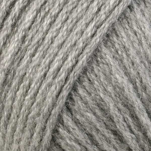 Skein of Berroco Comfort DK DK weight yarn in the color Ash Gray (Green) for knitting and crocheting.