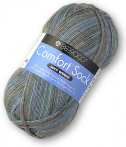 Skein of Berroco Comfort Sock Sock weight yarn in the color Southland (Blue) for knitting and crocheting.
