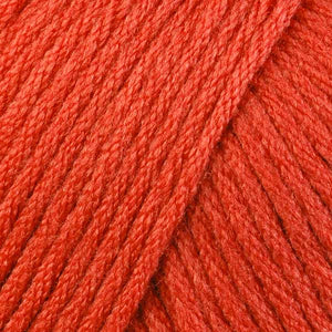 Skein of Berroco Comfort Worsted Worsted weight yarn in the color Persimmon (Orange) for knitting and crocheting.