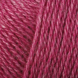 Skein of Berroco Folio DK weight yarn in the color Bayberry (Pink) for knitting and crocheting.