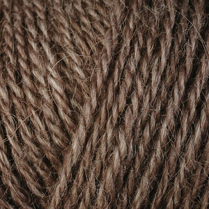 Skein of Berroco Folio DK weight yarn in the color Birch (Brown) for knitting and crocheting.
