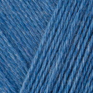 Skein of Berroco Folio DK weight yarn in the color Carribean (Blue) for knitting and crocheting.