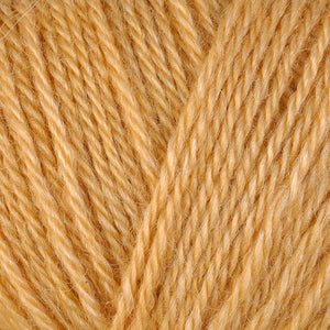 Skein of Berroco Folio DK weight yarn in the color Mango (Yellow) for knitting and crocheting.
