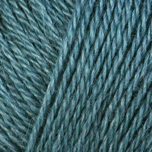 Skein of Berroco Folio DK weight yarn in the color Pacific (Blue) for knitting and crocheting.