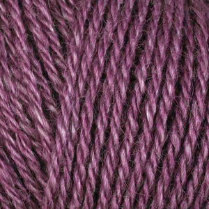 Skein of Berroco Folio DK weight yarn in the color Raspberry Coulis (Pink) for knitting and crocheting.