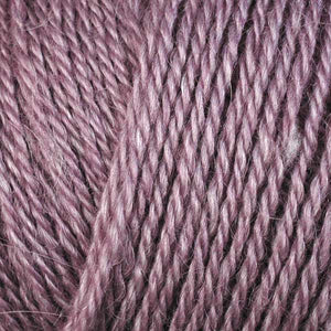 Skein of Berroco Folio DK weight yarn in the color Tea Rose (Pink) for knitting and crocheting.