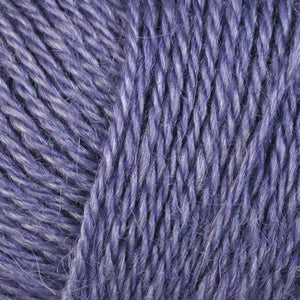 Skein of Berroco Folio DK weight yarn in the color Violet (Purple) for knitting and crocheting.