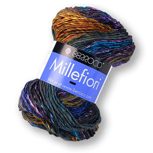 Skein of Berroco Millefiori Worsted weight yarn in the color Gladiolus (Blue) for knitting and crocheting.