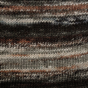Skein of Berroco Millefiori Worsted weight yarn in the color Terra (Black) for knitting and crocheting.