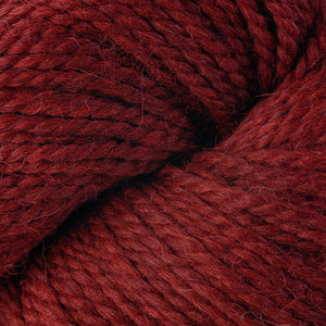 Skein of Berroco Ultra Alpaca Chunky Bulky weight yarn in the color Redwood Mix (Red) for knitting and crocheting.