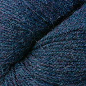 Skein of Berroco Ultra Alpaca Worsted weight yarn in the color Blueberry Mix (Blue) for knitting and crocheting.
